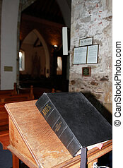 closed bible - a bible on a stand in an old church