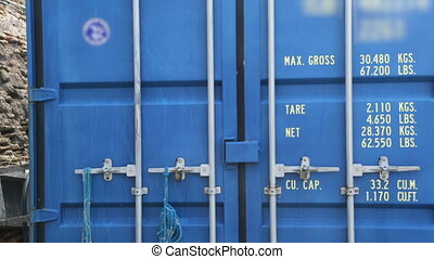 Closed blue container in port