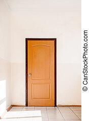 Closed door in empty hallway