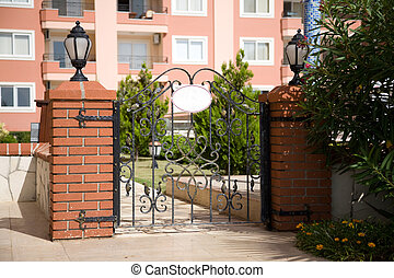 closed gates to the hotel garden