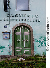 closed guest house facade, symbol of gastronomy, crisis,...
