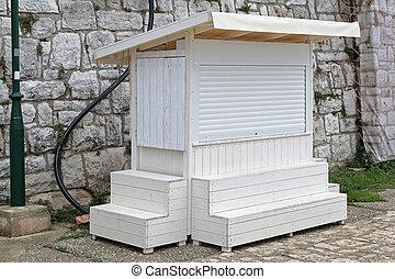 Closed kiosk - Closed white small vending kiosk booth