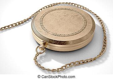 Closed Ornate Locket - A closeup of a closed intricate gold...