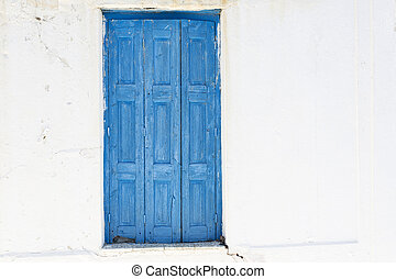 Closed painted door in Greece