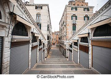 Closed Shops on Rialto Bridge in Venice. Italy. View on Salizzada Pio X Street.