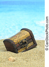 \Closed treasure chest on a beach