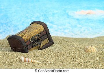 Closed treasure chest on a beach