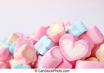Closed Up a Pink and White Heart Shaped Marshmallow on the Pile of Pastel Color Flower Shaped Marshmallow Candies