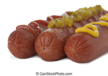 Closed up cooked hotdogs with toppings