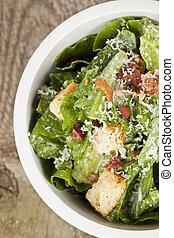 cropped bowl of caesar salad