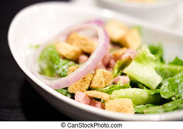 Closed up cropped bowl of caesar salad