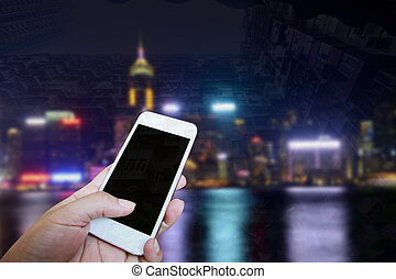 Closed up hand of man touch screen, Night view background