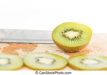 Closed up sliced kiwi fruit on white