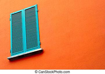 closed window on orange wall