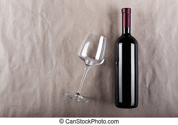 Closed wine bottle with a glass