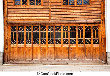 Closed wooden door and wall