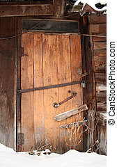 closed wooden door of old shed