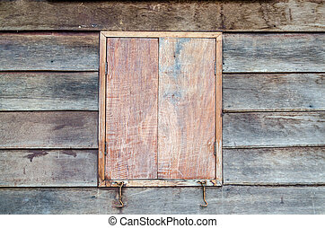 Closed wooden window of retro house in rural of Thailand