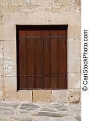 Closed wooden window shutters