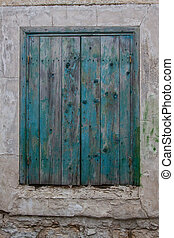 Closed wooden window shutters