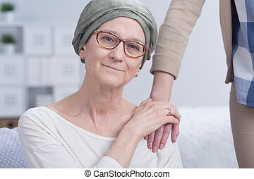 Closeness and support help to survive - Woman with cancer is...