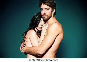 closeness - Beautiful naked couple in love in a tender...