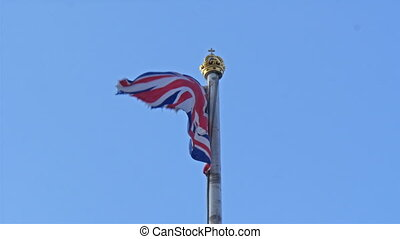Closer look of the flag waving on the pole