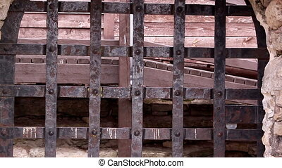 Closer look of the rusty metal gate of the old castle -...