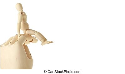Closer view of rotation of wooden toy giant arm with little toy man climbing