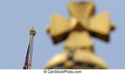 Closer view of the flag pole with golden tip crown
