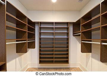 closet - large walk in closet with modular shelves