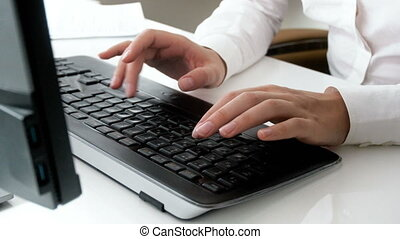 Closeup 4k footage of businesswoman hands typing on computer keyboard at office