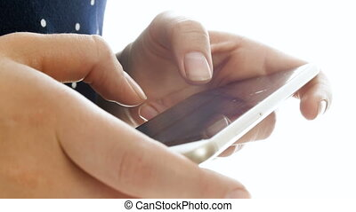 Closeup 4k footage of female fingers typing message on smart phone touch screen
