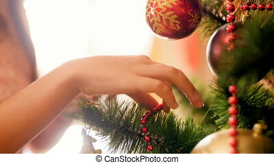 Closeup 4k footage of girls hands putting baubles and...