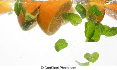 Closeup 4k footage of juicy cut oranges and lemons with mint...