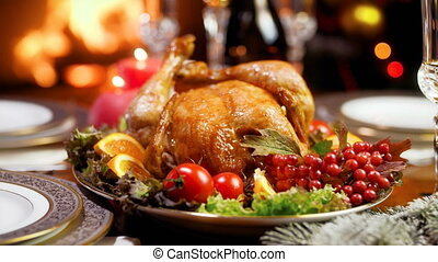 Closeup 4k footage of served table with roasted chicken and vegetables for Christmas dinner