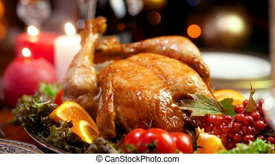 Closeup 4k footage of tasty Christmas turkey served on wooden table in living room. Dining table served for big family on winter holidays and celebrations.