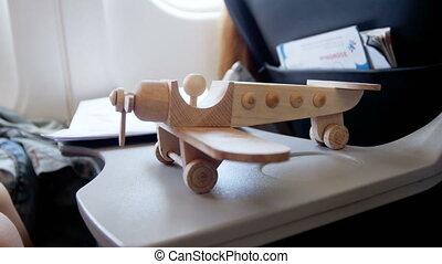 Closeup 4k footage of toy wooden airplane standing on...
