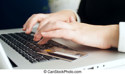 Closeup 4k footage of young woman doing online purchases with credit card