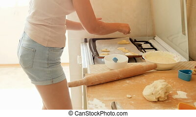 Closeup 4k footage of young woman making pie and cookies on...