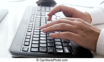 Closeup 4k pan footage of businesswoman typing message on computer keyboard