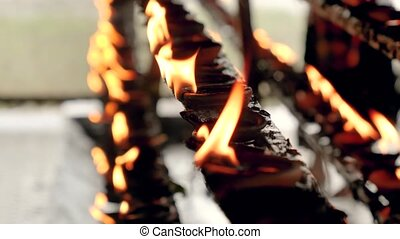 Closeup 4k video of burning fire in oil lamps at temple ...