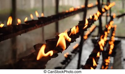 CLoseup 4k video of burning sacred fire in the oil lamps at ...
