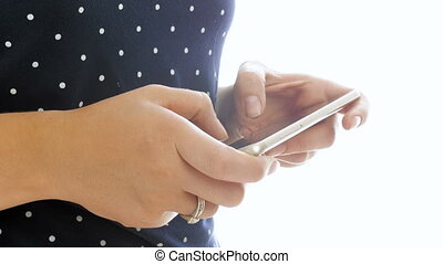 closeup 4k video of female hands typing message on cell phone
