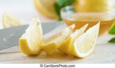 Closeup 4k video of ingredient for natural lemonade lying on...