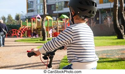 Closeup 4k video of little boy wearing protective helmet ...