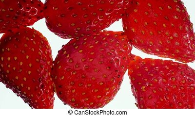 Closeup 4k video of lotd of ripe strawberries squeezing and ...