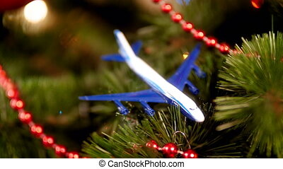 Closeup 4k video of miniature airplane lying on Christmas...