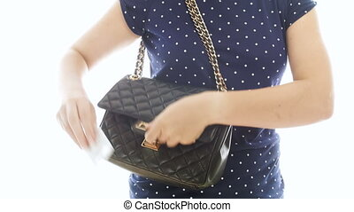 Closeup 4k video of young woman taking condom out of handbag...
