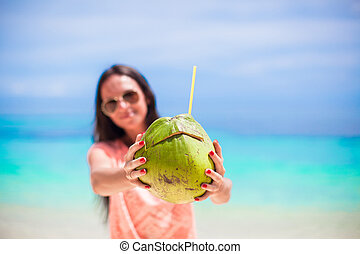 Closeup a coconut in hands of young girl